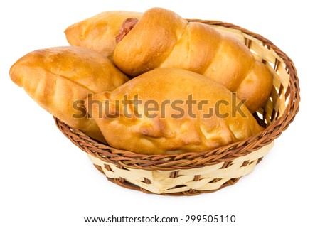 Fresh baked pies in wicker basket isolated on white background - stock photo
