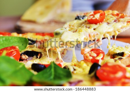 fresh baked pizza with olives and peppers
