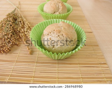 Fresh baked roll muffins with spelt, millet and rice - stock photo