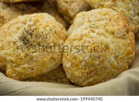 Fresh baked scones with cheese and herbs. - stock photo