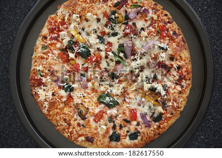 Fresh Baked Vegetarian Pizza Hot From The Oven - stock photo