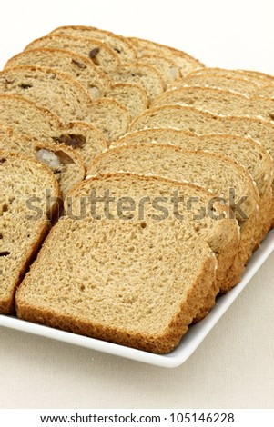 fresh baked  whole grain whole wheat raisins and nuts bread with lots of assorted and  healthy ingredients