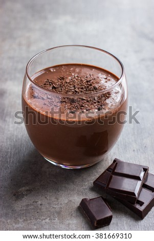 fresh banana and chocolate smoothie in glass, selective focus - stock photo