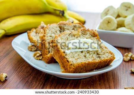 fresh banana nut bread with walnuts and butter
