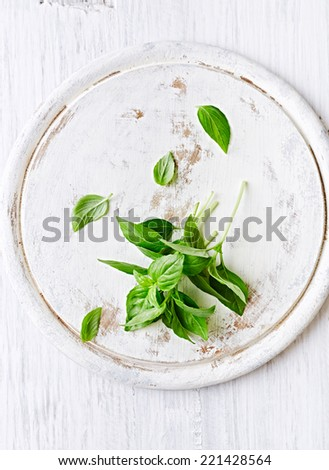 Fresh Basil on a Chopping Board - stock photo