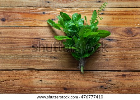 Fresh basil on old wooden background