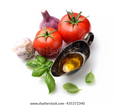 fresh basil, tomatoes and oil on a white background - stock photo