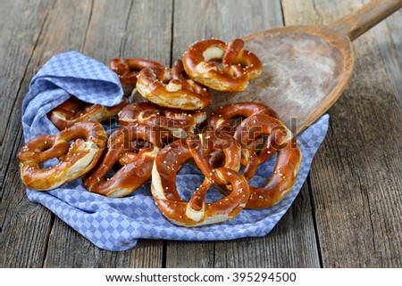 Fresh Bavarian pretzels on a vintage baking board - stock photo