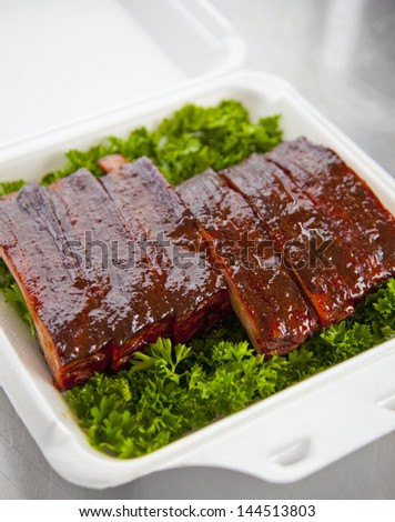 Fresh bbq ribs in a box
