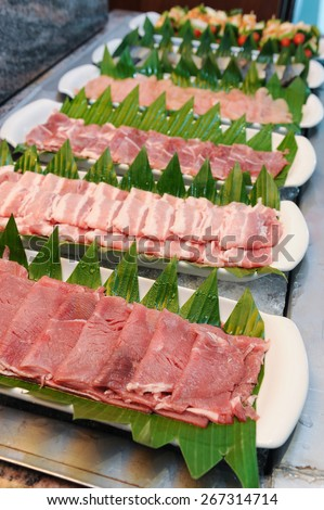 Fresh beef bacon and pork for sukiyaki in buffet line - stock photo