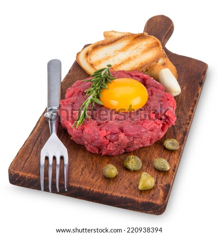 fresh beef tartar with egg, close-up.
