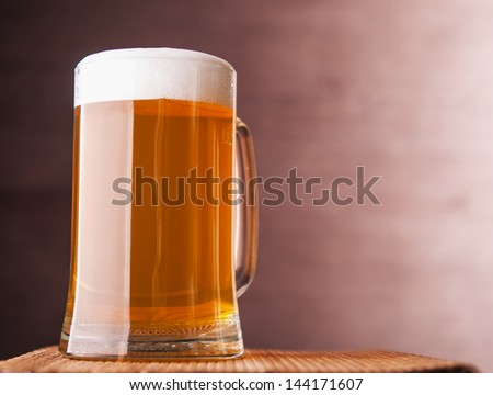 Fresh beer on wooden table