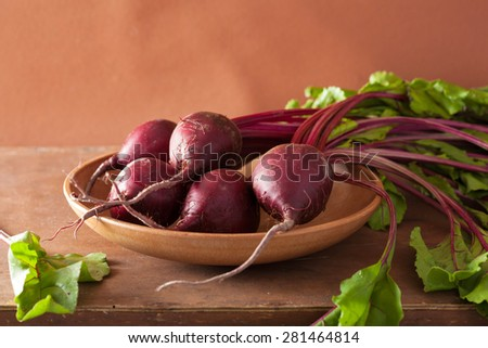 fresh beet in wooden bowl - stock photo