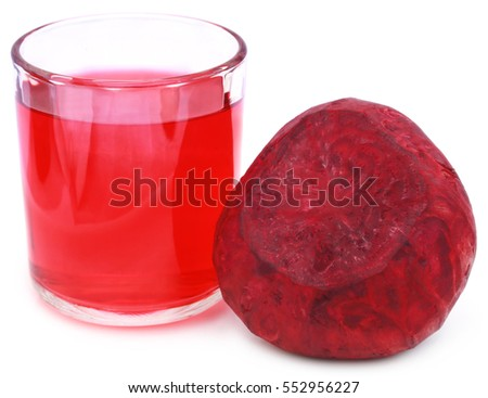 Fresh Beet with juice in glass over white background