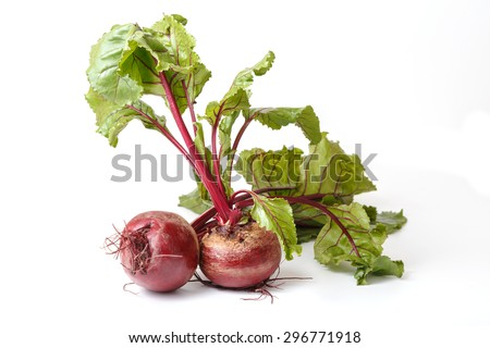 Fresh beet with leaves on a white background. - stock photo