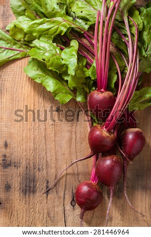 fresh beetroot on wooden background - stock photo