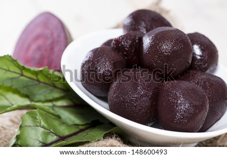Fresh Beetroot on wooden background (macro shot)