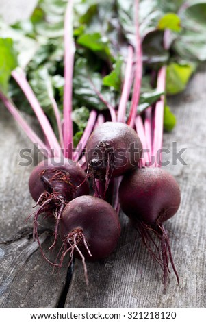 fresh beetroot on wooden surface - stock photo