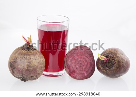 Fresh beetroot with half isolated on white - stock photo