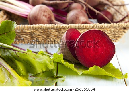 Fresh beets on a wooden board - stock photo