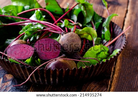 Fresh beets on a wooden table - stock photo