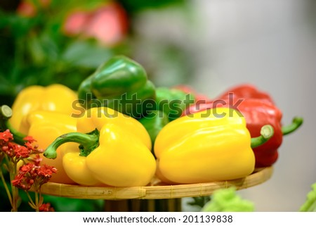 Fresh Bell Pepper healthy paprika, sweet pepper vegetable green yellow red Bell Pepper food fresh healthy natural paprika on brown bamboo tray - stock photo