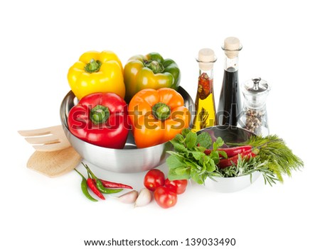 Fresh bell peppers, herbs and condiments. Isolated on white background - stock photo