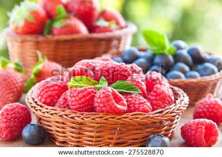 Fresh berries in basket - stock photo