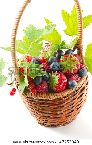 Fresh berries in the basket isolated on white background