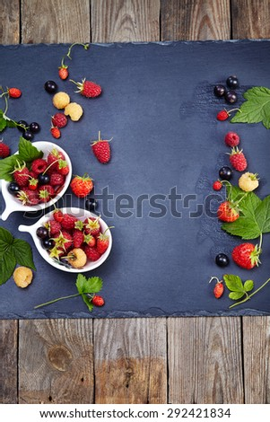 Fresh Berries on Slate Background (Strawberries, Raspberries and Blackberry). Agriculture, Gardening, Harvest Concept - stock photo
