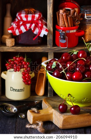 Fresh berry and food ingredients for cooking jam on an old wooden shelves. Rustic style. - stock photo