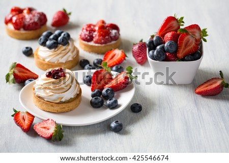 Fresh berry tarts with strawberry and blueberry  - stock photo