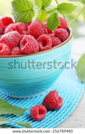 Fresh big juicy raspberry in a bowl - stock photo