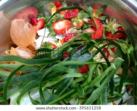 Fresh bio-waste with strawberries and cucumber for composting - stock photo