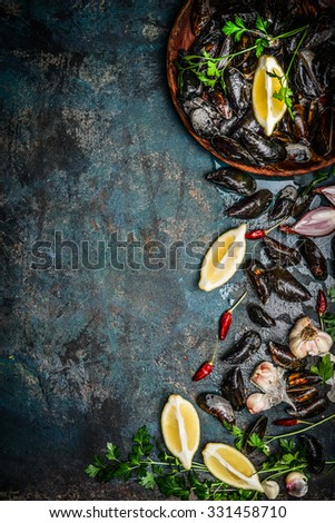 Fresh black mussels in wooden bowl with lemon and ingredients for cooking on dark rustic background, top view, border, vertical. Seafood concept - stock photo
