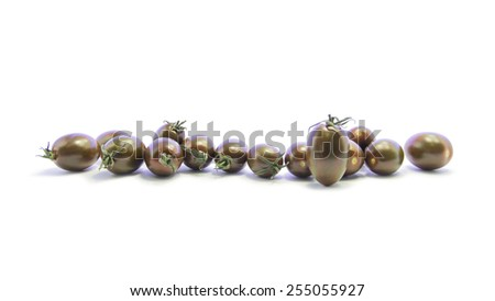 Fresh black tomatoes mixed size in straight line on white background
