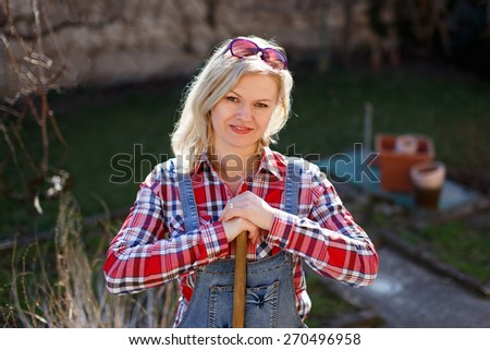 Fresh blonde woman outdoor works on sunny day - stock photo