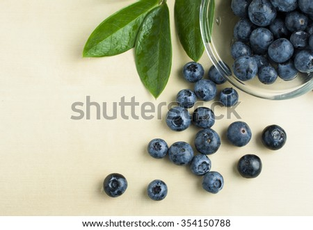 Fresh blue berries on wooden table - stock photo