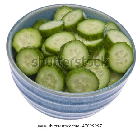 Fresh blue bowl of sliced cucumbers isolated on white with a clipping path.