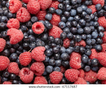 fresh blueberries and raspberries - stock photo