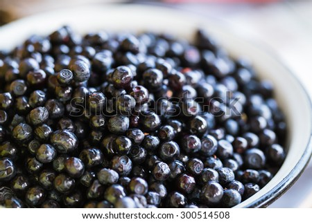 Fresh blueberries in a bowl on a wooden background