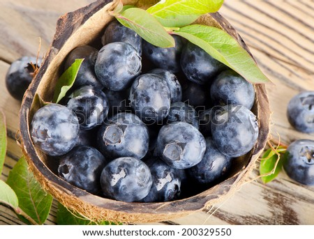 Fresh blueberries on a wooden background. Selective focus - stock photo