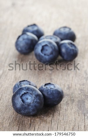 fresh blueberries on wood table, rustic style