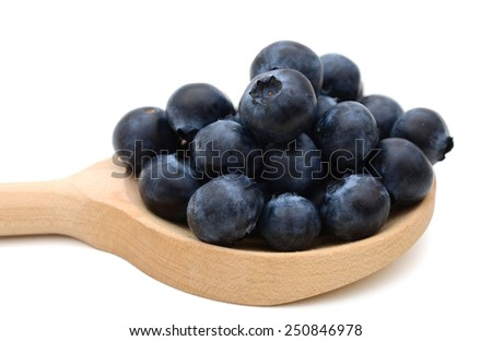 fresh blueberries on wooden spoon - stock photo