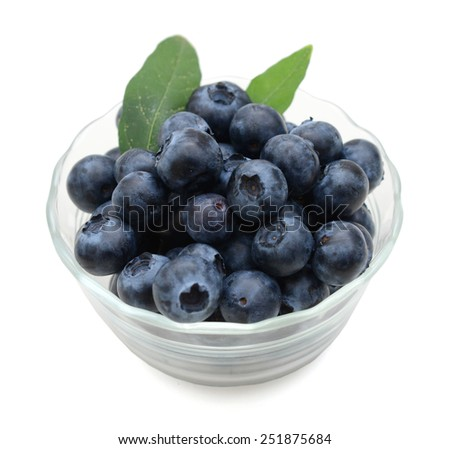 fresh blueberries with leaves in a bowl isolated on white - stock photo