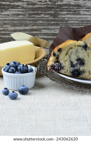 Fresh Blueberry Muffin on Rustic Burlap Background