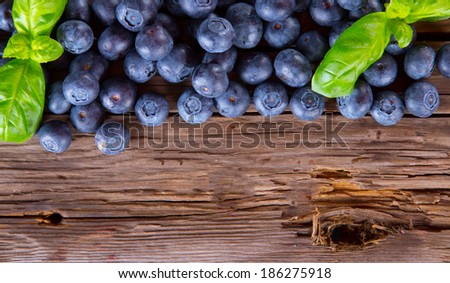 Fresh blueberry on wooden table. Berry - wood. Garden fruits. Organic - stock photo