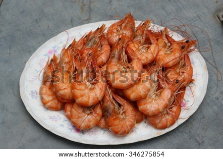 Fresh boiled or steamed shrimps for seafood background - stock photo