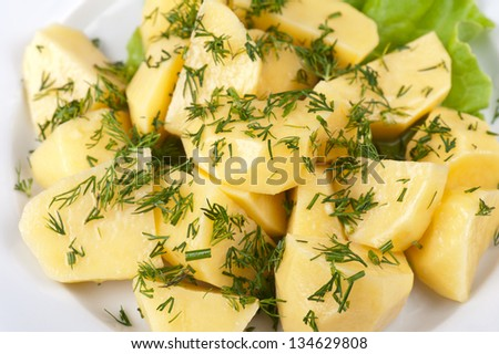 fresh boiled potatoes with greens