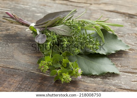 Fresh bouquet garni with different herbs - stock photo